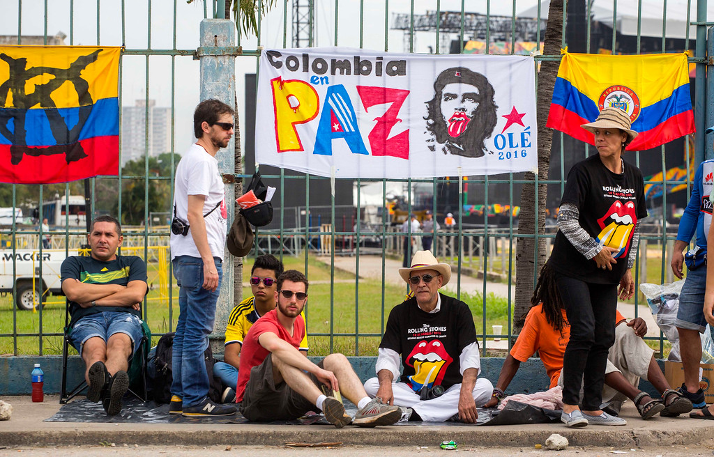 . Fans wait outside the venue where the Rolling Stones will play their concert in Havana, Cuba, Friday, March 25, 2016. The Stones are performing in a free concert in Havana Friday, becoming the most famous act to play Cuba since its 1959 revolution.(AP Photo/Desmond Boylan)