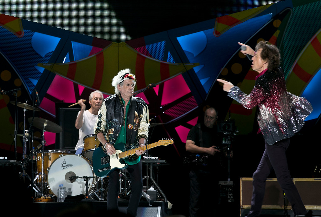 . Mick Jagger, right, of the The Rolling Stones performs as Keith Richards plays the guitar and Charlie Watts plays the drums, in Havana, Cuba, Friday March 25, 2016. The Stones are performing in a free concert in Havana Friday, becoming the most famous act to play Cuba since its 1959 revolution.(AP Photo/Enric Marti)