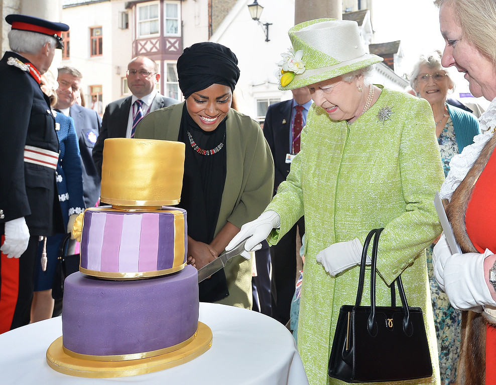 . Queen Elizabeth II receives a birthday cake from Nadiya Hussain, winner of the Great British Bake Off, during her 90th Birthday Walkabout on April 21, 2016 in Windsor, England. Today is Queen Elizabeth II\'s 90th Birthday. The Queen and Duke of Edinburgh will be carrying out engagements in Windsor.  (Photo by John Stillwell - WPA Pool/Getty Images)