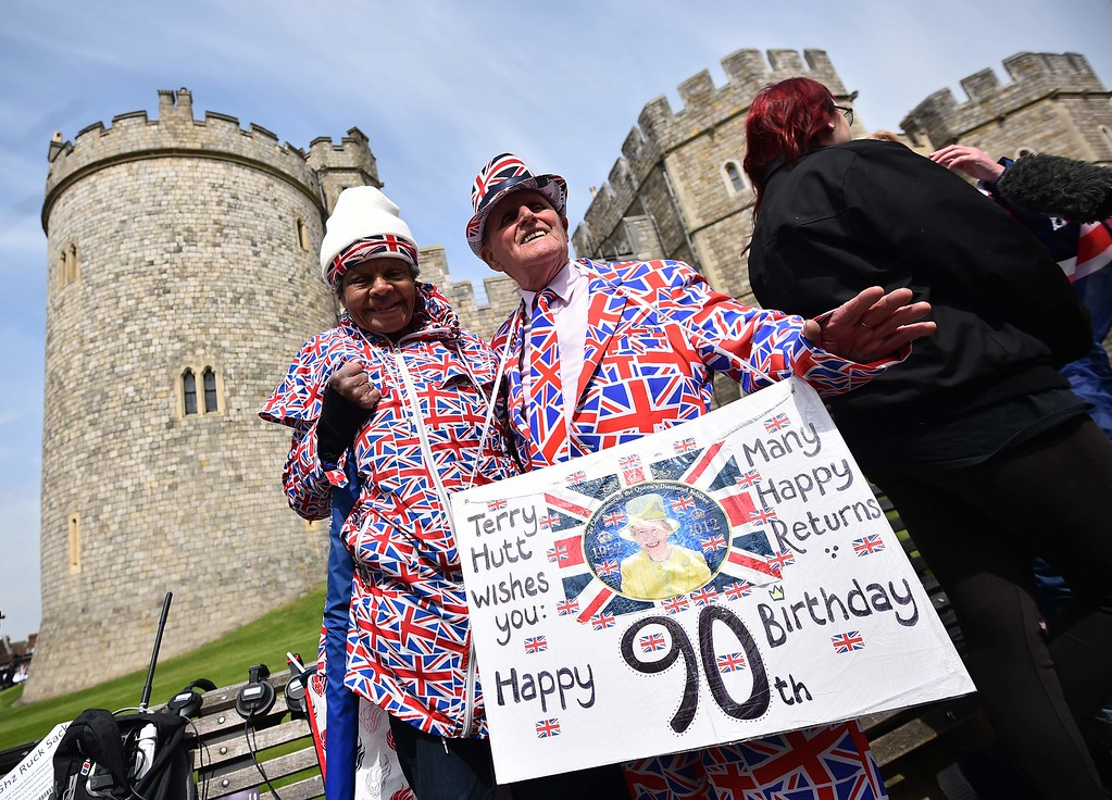 . Royal supporters are pictured outside Windsor Castle, west of London, on April 21, 2016, as Britain\'s Queen Elizabeth II celebrates her 90th birthday.  Britain celebrates Queen Elizabeth II\'s 90th birthday on Thursday, with her eldest son Prince Charles paying tribute in a special radio broadcast and Prime Minister David Cameron leading a parliamentary homage. / AFP PHOTO / BEN STANSALL/AFP/Getty Images