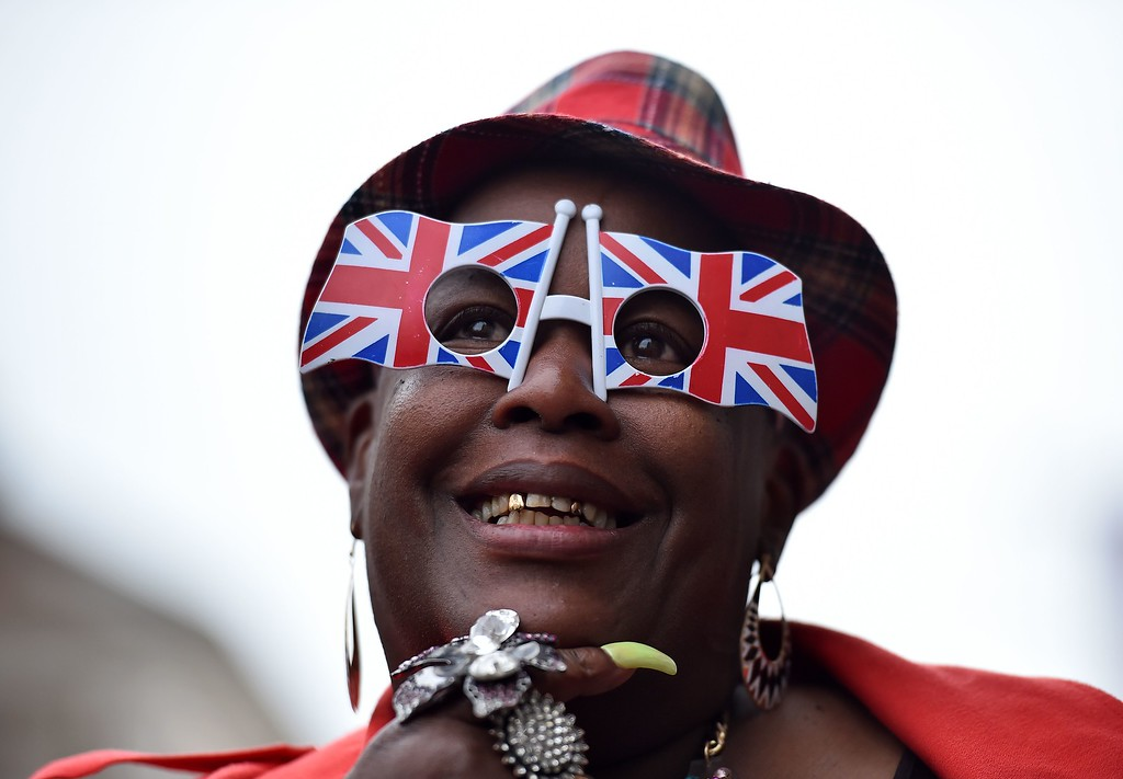 . A royal supporter is pictured outside Windsor Castle, west of London, on April 21, 2016, as Britain\'s Queen Elizabeth II celebrates her 90th birthday. Britain celebrates Queen Elizabeth II\'s 90th birthday on Thursday, with her eldest son Prince Charles paying tribute in a special radio broadcast and Prime Minister David Cameron leading a parliamentary homage. / AFP PHOTO / BEN STANSALL/AFP/Getty Images