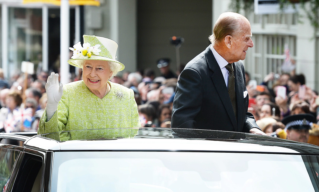 . Queen Elizabeth II and Prince Philip, Duke of Edinburgh travel through Windsor in an open top Range Rover after her 90th Birthday Walkabout on April 21, 2016 in Windsor, England. Today is Queen Elizabeth II\'s 90th Birthday. The Queen and Duke of Edinburgh will be carrying out engagements in Windsor.  (Photo by John Stillwell - WPA Pool/Getty Images)