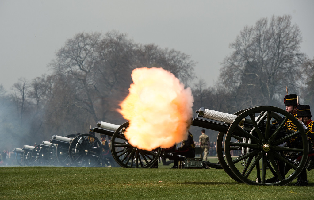 . A gun fires during a 41 gun royal salute to mark the 90th birthday of Queen Elizabeth II at Hyde Park on April 21, 2016 in London, England. 71 horses pulled six First World War-era 13-pounder field guns into place at Hyde Park to fire forty one blank shots. The soldiers, horses and guns are from The King\'s Troop Royal Horse Artillery who rode out from their forward mounting base in Wellington Barracks and are commanded by Major Robert Skeggs.  (Photo by Chris Ratcliffe/Getty Images)