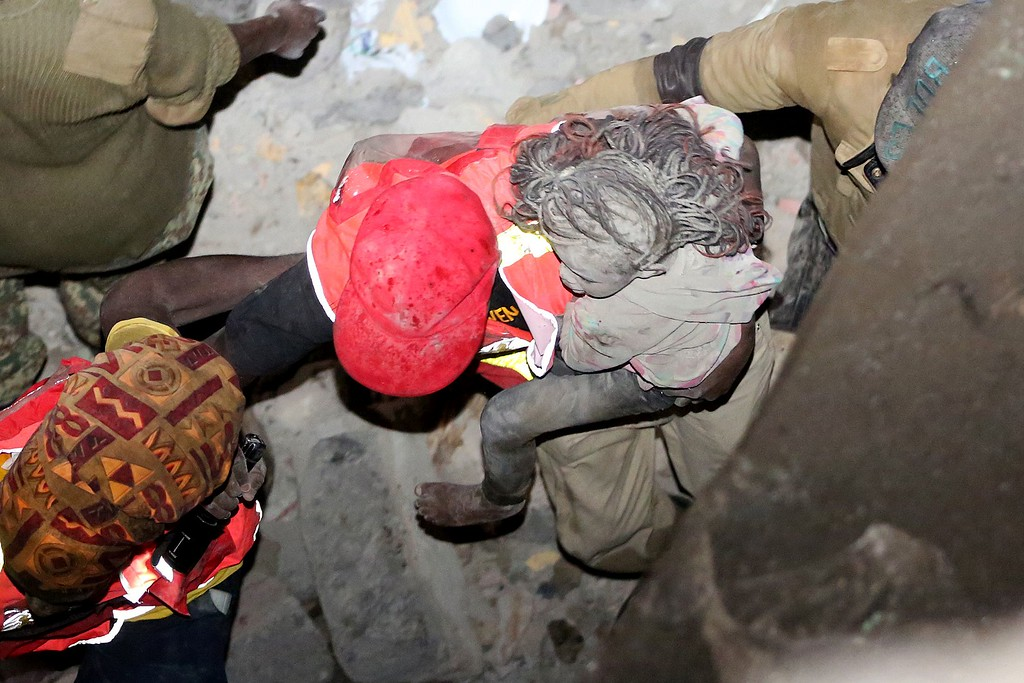 . A girl is rescued after a building collapsed in Nairobi late on April 29, 2016.  / AFP PHOTO / --/AFP/Getty Images