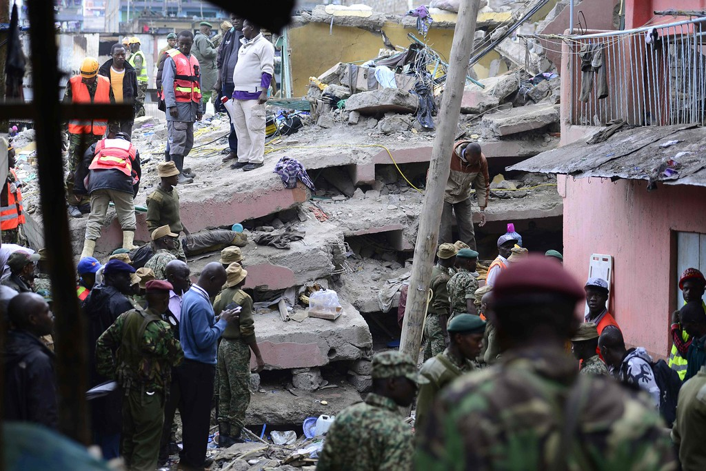 . Kenyan security forces and emergency personnel look for survivors under the rubble of a collapsed building in Nairobi on April 30, 2016.  / AFP PHOTO / JOHN MUCHACHA/AFP/Getty Images