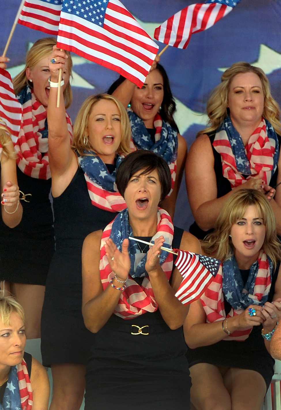 . The American golfers showed their national pride during opening ceremonies Thursday. Following a final practice round at the Colorado Golf Club the United States team and the team from Europe participated in opening ceremonies to being competition for the Solheim Cup Thursday evening, August 15, 2013. Photo By Karl Gehring/The Denver Post