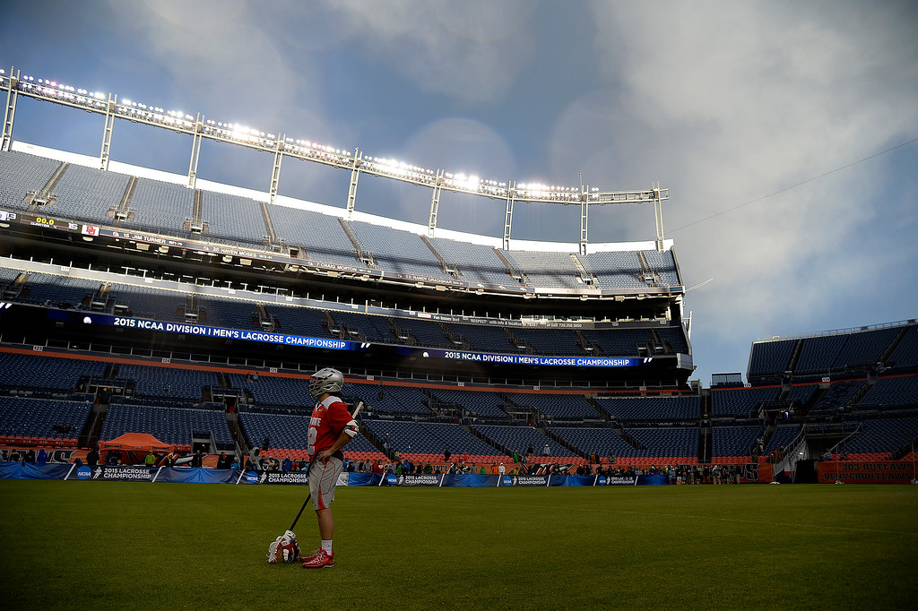 . Ben Karr (32) of the Ohio State Buckeyes stands on the field after the second half of Denver\'s 15-13 NCAA tournament quarterfinal win. The Denver Pioneers played the Ohio State Buckeyes at Sports Authority field at Mile High on Saturday, May 16, 2015. (Photo by AAron Ontiveroz/The Denver Post)
