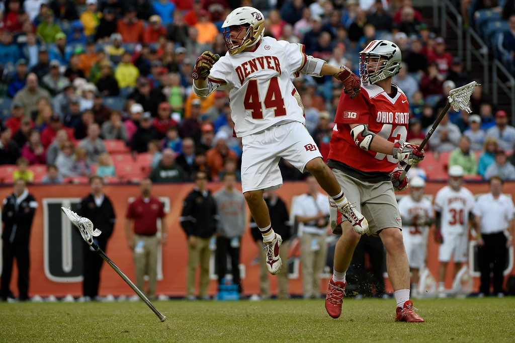 . Sean Cannizzaro (44) of the Denver Pioneers goes airborne as the Pioneers attempt a long pass for a goal with less than 10 seconds to play against the Ohio State Buckeyes during the first half of their NCAA tournament quarterfinal match. The Denver Pioneers played the Ohio State Buckeyes at Sports Authority field at Mile High on Saturday, May 16, 2015. (Photo by AAron Ontiveroz/The Denver Post)