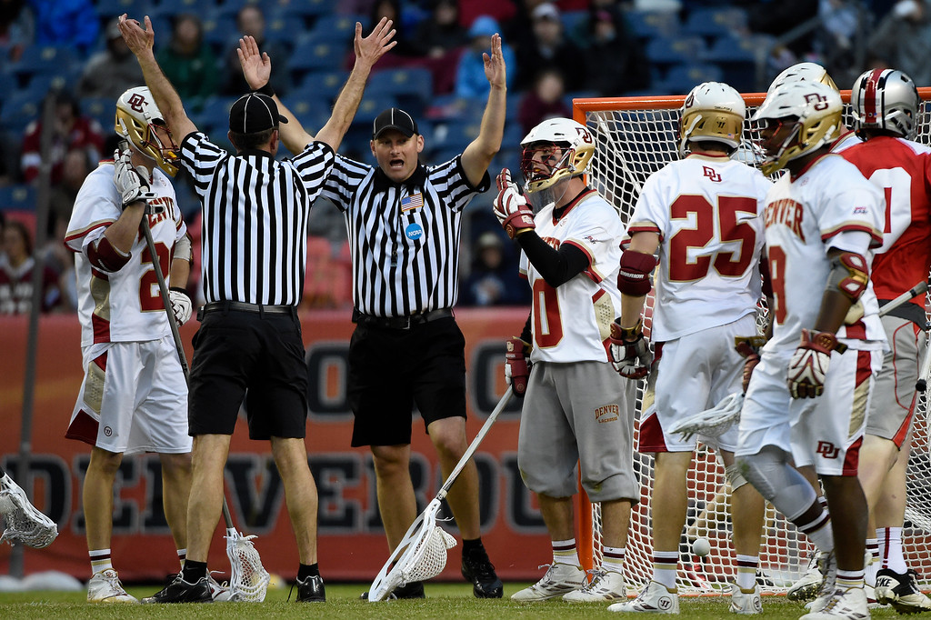 . Ryan LaPlante (10) of the Denver Pioneers argues a goal with referees by  Jake Withers (18) of the Ohio State Buckeyes during the second half of Denver\'s 15-13 NCAA tournament quarterfinal win. The Denver Pioneers played the Ohio State Buckeyes at Sports Authority field at Mile High on Saturday, May 16, 2015. (Photo by AAron Ontiveroz/The Denver Post)
