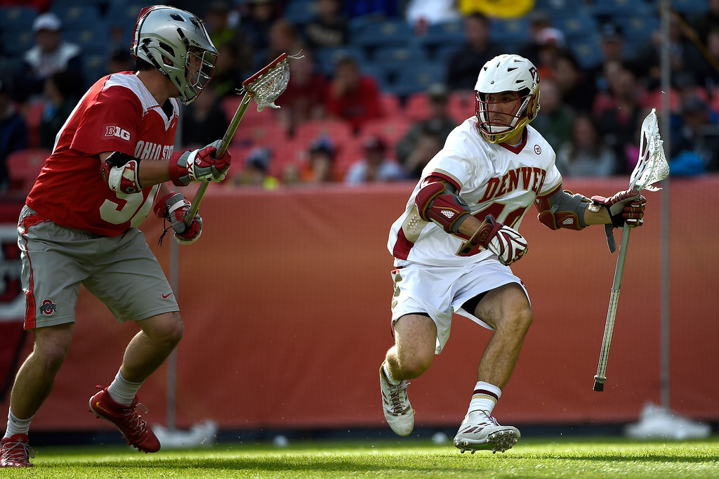 . Connor Cannizzaro (40) of the Denver Pioneers is defended by  Robby Haus (50) of the Ohio State Buckeyes during the first half of their NCAA tournament quarterfinal match. The Denver Pioneers played the Ohio State Buckeyes at Sports Authority field at Mile High on Saturday, May 16, 2015. (Photo by AAron Ontiveroz/The Denver Post)