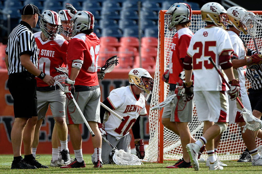 . Ryan LaPlante (10) of the Denver Pioneers kneels after giving up a goal to  John Kelly (10) of the Ohio State Buckeyes during the first half of their NCAA tournament quarterfinal match. The Denver Pioneers played the Ohio State Buckeyes at Sports Authority field at Mile High on Saturday, May 16, 2015. (Photo by AAron Ontiveroz/The Denver Post)