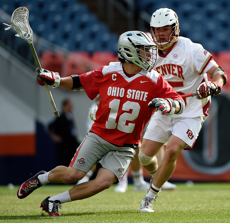 . Garret Holst (25) of the Denver Pioneers defends  David Planning (12) of the Ohio State Buckeyes during the first half of their NCAA tournament quarterfinal match. The Denver Pioneers played the Ohio State Buckeyes at Sports Authority field at Mile High on Saturday, May 16, 2015. (Photo by AAron Ontiveroz/The Denver Post)