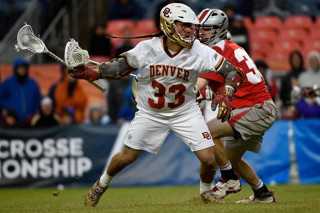 . Zach Miller (33) of the Denver Pioneers works offensively against the Ohio State Buckeyes during the second half of Denver\'s 15-13 NCAA tournament quarterfinal win. The Denver Pioneers played the Ohio State Buckeyes at Sports Authority field at Mile High on Saturday, May 16, 2015. (Photo by AAron Ontiveroz/The Denver Post)