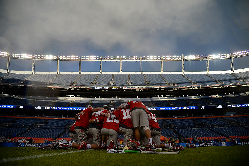 . Ohio State Buckeyes players gather at midfield after the second half of Denver\'s 15-13 NCAA tournament quarterfinal win. The Denver Pioneers played the Ohio State Buckeyes at Sports Authority field at Mile High on Saturday, May 16, 2015. (Photo by AAron Ontiveroz/The Denver Post)