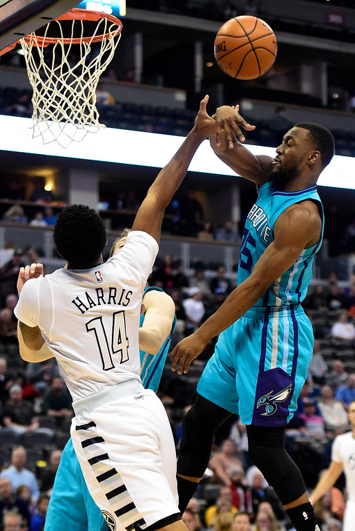 . Kemba Walker (15) of the Charlotte Hornets fouls Gary Harris (14) of the Denver Nuggets during the first quarter. The Denver Nuggets hosted the Charlotte Hornets at the Pepsi Center on Sunday, January 10, 2016. (Photo by AAron Ontiveroz/The Denver Post)