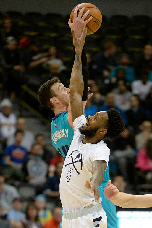 . Frank Kaminsky III (44) of the Charlotte Hornets out rebounds Will Barton (5) of the Denver Nuggets during the second quarter. The Denver Nuggets hosted the Charlotte Hornets at the Pepsi Center on Sunday, January 10, 2016. (Photo by AAron Ontiveroz/The Denver Post)