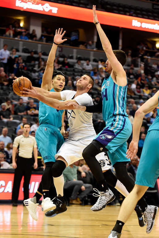 . Danilo Gallinari (8) of the Denver Nuggets drives between Jeremy Lin (7) of the Charlotte Hornets and Frank Kaminsky III (44) during the first quarter. The Denver Nuggets hosted the Charlotte Hornets at the Pepsi Center on Sunday, January 10, 2016. (Photo by AAron Ontiveroz/The Denver Post)
