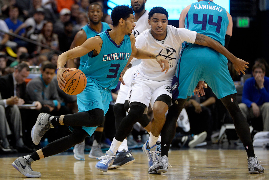 . Gary Harris (14) of the Denver Nuggets takes a screen from Frank Kaminsky III (44) of the Charlotte Hornets as Jeremy Lamb (3) drives during the first quarter. The Denver Nuggets hosted the Charlotte Hornets at the Pepsi Center on Sunday, January 10, 2016. (Photo by AAron Ontiveroz/The Denver Post)