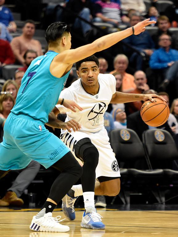 . Gary Harris (14) of the Denver Nuggets drives on Jeremy Lin (7) of the Charlotte Hornets during the first quarter. The Denver Nuggets hosted the Charlotte Hornets at the Pepsi Center on Sunday, January 10, 2016. (Photo by AAron Ontiveroz/The Denver Post)