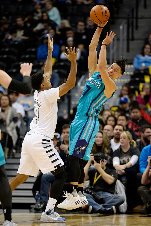 . Gary Harris (14) of the Denver Nuggets forces Jeremy Lin (7) of the Charlotte Hornets to pass during the second quarter. The Denver Nuggets hosted the Charlotte Hornets at the Pepsi Center on Sunday, January 10, 2016. (Photo by AAron Ontiveroz/The Denver Post)