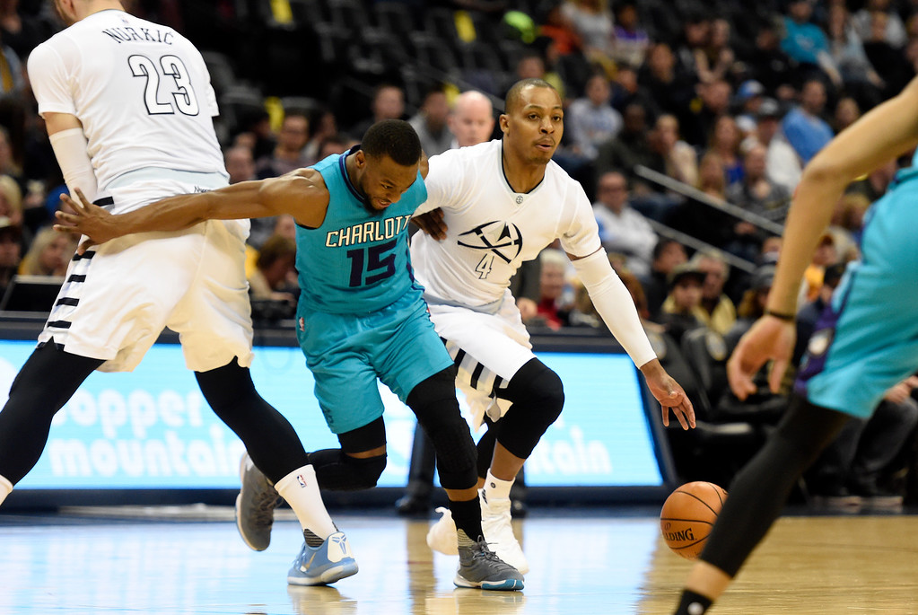 . Randy Foye (4) of the Denver Nuggets drives as Jusuf Nurkic (23) sets a screen on Kemba Walker (15) of the Charlotte Hornets during the first quarter. The Denver Nuggets hosted the Charlotte Hornets at the Pepsi Center on Sunday, January 10, 2016. (Photo by AAron Ontiveroz/The Denver Post)