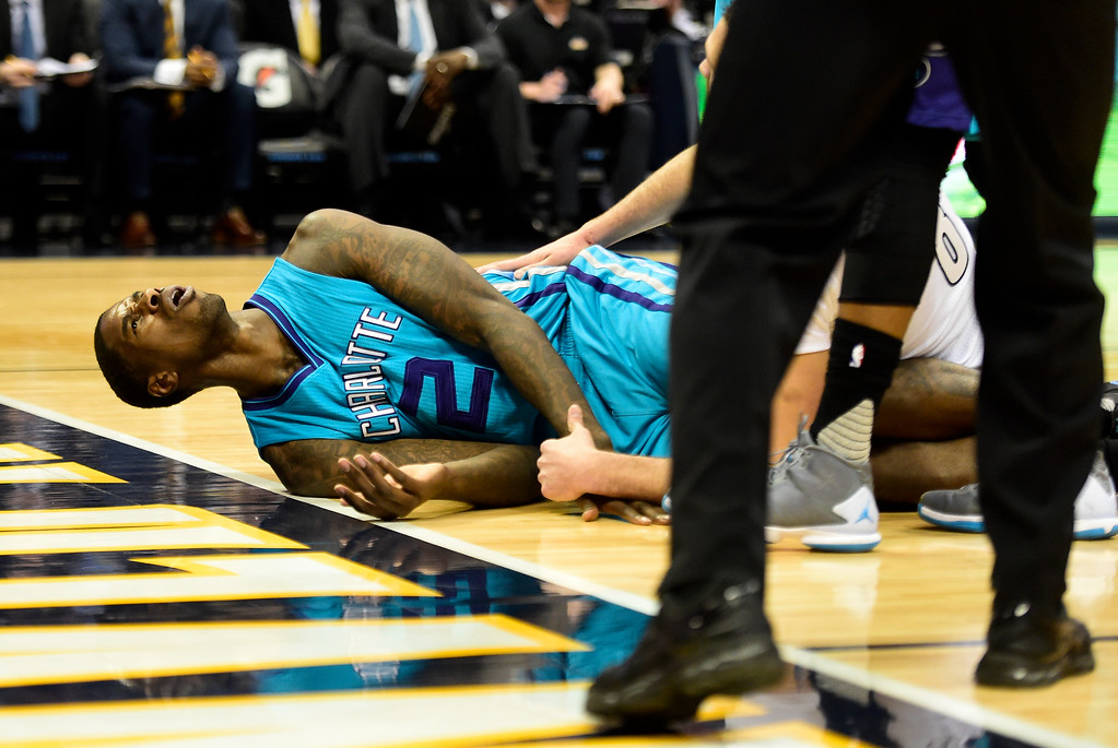 . Marvin Williams (2) of the Charlotte Hornets reacts to fouling Danilo Gallinari (8) of the Denver Nuggets during the first quarter. The Denver Nuggets hosted the Charlotte Hornets at the Pepsi Center on Sunday, January 10, 2016. (Photo by AAron Ontiveroz/The Denver Post)