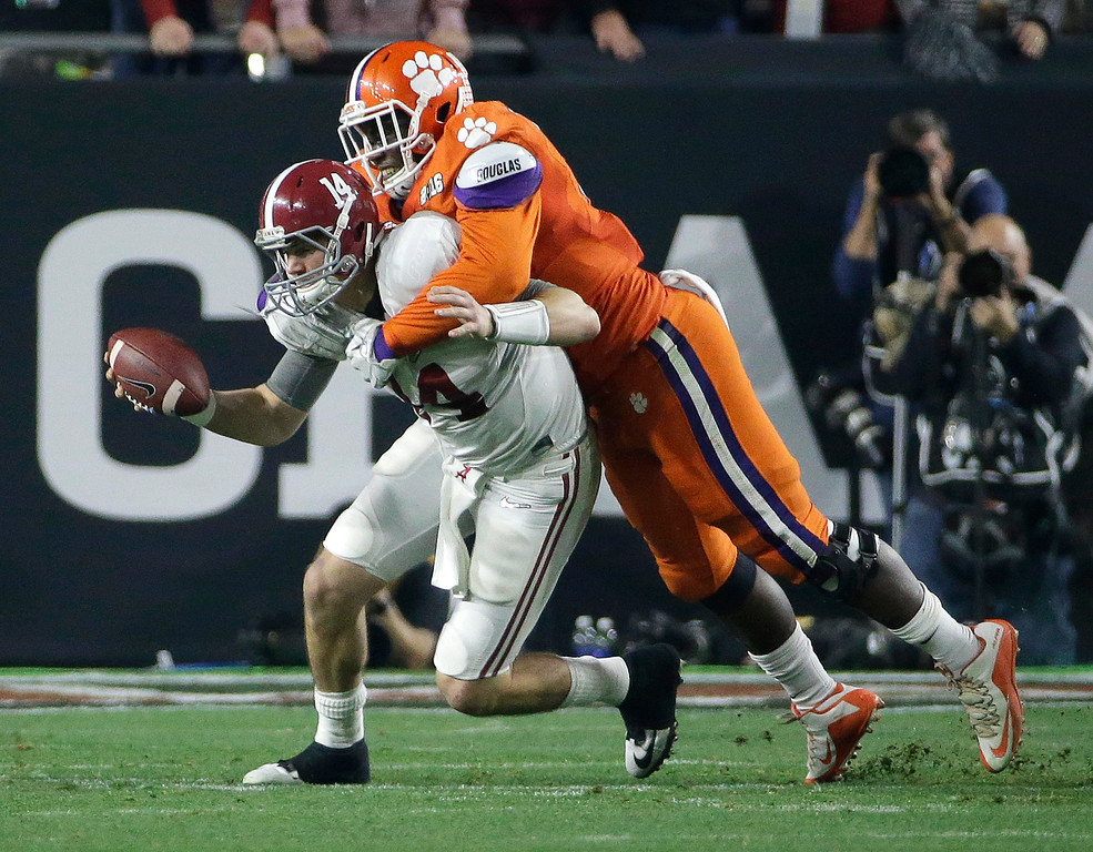 . Clemson\'s Shaq Lawson, right, sacks Alabama\'s Jake Coker during the first half of the NCAA college football playoff championship game Monday, Jan. 11, 2016, in Glendale, Ariz. (AP Photo/David J. Phillip)