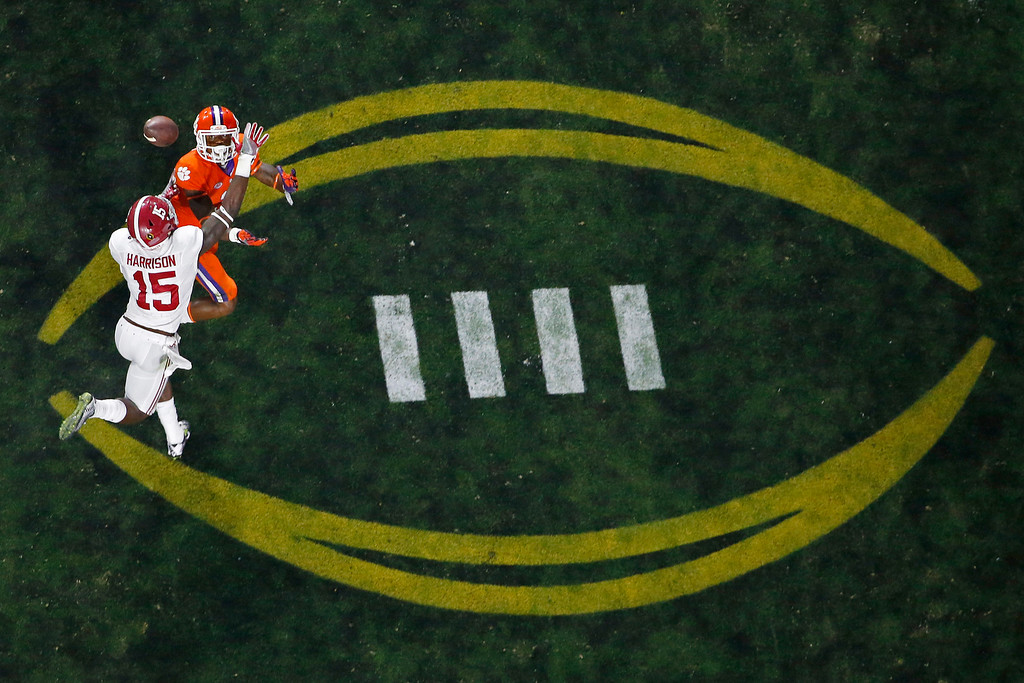 . Alabama\'s Ronnie Harrison (15) breaks up a pass intended for Clemson\'s Artavis Scott during the second half of the NCAA college football playoff championship game Monday, Jan. 11, 2016, in Glendale, Ariz. (AP Photo/Ross D. Franklin)