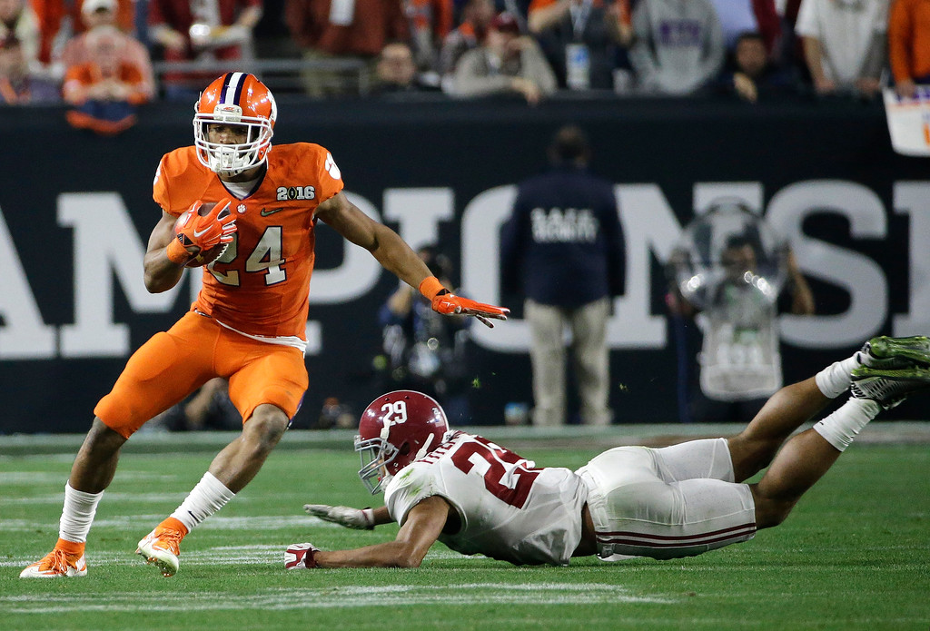 . Clemson\'s Zac Brooks, left, runs past Alabama\'s Minkah Fitzpatrick during the second half of the NCAA college football playoff championship game Monday, Jan. 11, 2016, in Glendale, Ariz. (AP Photo/David J. Phillip)