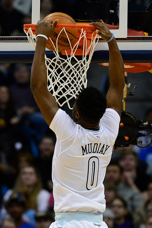 . DENVER, CO - JANUARY 13: Emmanuel Mudiay (0) of the Denver Nuggets dunks on a break away during the second half at the Pepsi Center on January 13, 2016 in Denver, Colorado. The Nuggets defeated the Warriors 112-110, giving the Warriors their third loss of the season. (Photo by Brent Lewis/The Denver Post)