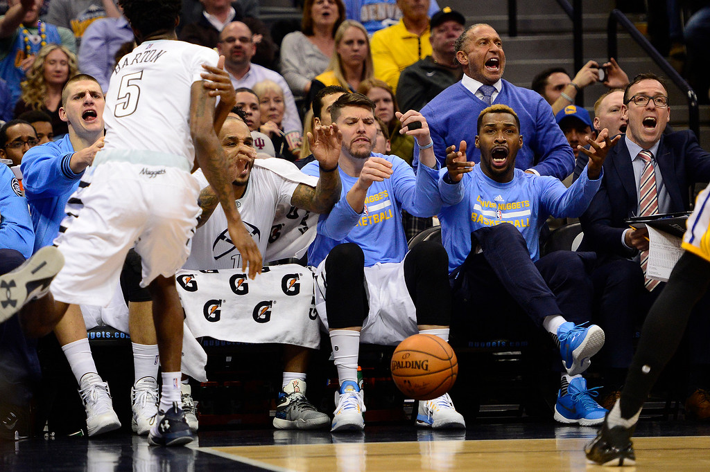 . DENVER, CO - JANUARY 13: The Denver Nuggets bench reacts after the referee didn\'t call a foul on Golden State Warriors for fouling Will Barton (5) during the second half at the Pepsi Center on January 13, 2016 in Denver, Colorado. The Nuggets defeated the Warriors 112-110, giving the Warriors their third loss of the season. (Photo by Brent Lewis/The Denver Post)