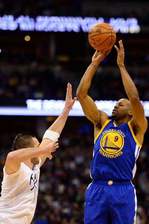 . DENVER, CO - JANUARY 13: Andre Iguodala (9) of the Golden State Warriors shoots over Danilo Gallinari (8) of the Denver Nuggets during the second half at the Pepsi Center on January 13, 2016 in Denver, Colorado. The Nuggets defeated the Warriors 112-110, giving the Warriors their third loss of the season. (Photo by Brent Lewis/The Denver Post)