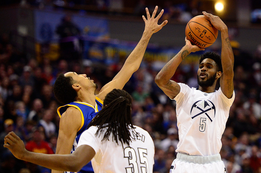. DENVER, CO - JANUARY 13: Will Barton (5) of the Denver Nuggets shoots over the defense of Shaun Livingston (34) of the Golden State Warriors during the first half at the Pepsi Center on January 13, 2016 in Denver, Colorado.  (Photo by Brent Lewis/The Denver Post)