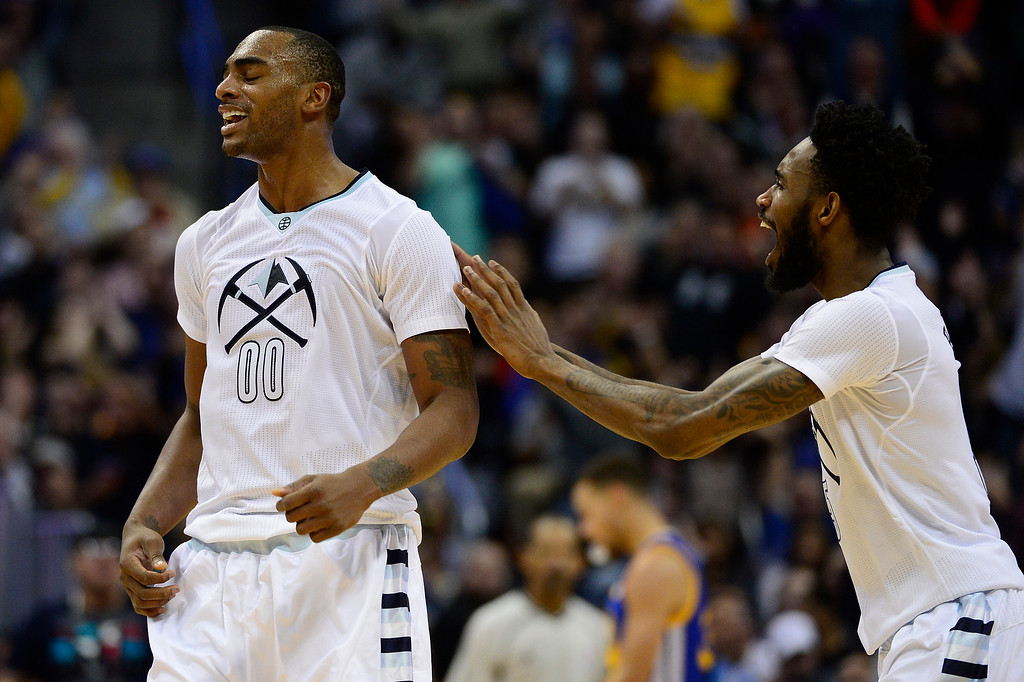 . DENVER, CO - JANUARY 13: Darrell Arthur (00) of the Denver Nuggets celebrates with Will Barton (5) of the Denver Nuggets after scoring a three to put the Denver Nuggets ahead during the second half at the Pepsi Center on January 13, 2016 in Denver, Colorado. The Nuggets defeated the Warriors 112-110, giving the Warriors their third loss of the season. (Photo by Brent Lewis/The Denver Post)