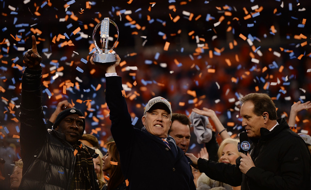 . DENVER, CO - JANUARY 24: John Elway celebrates after the Denver Broncos won the AFC championship game against New England Patriots at Sports Authority Field at Mile High Stadium in Denver, January, 24, 2016. The Broncos will now go on to play in Super Bowl 50. (Photo by RJ Sangosti/The Denver Post)