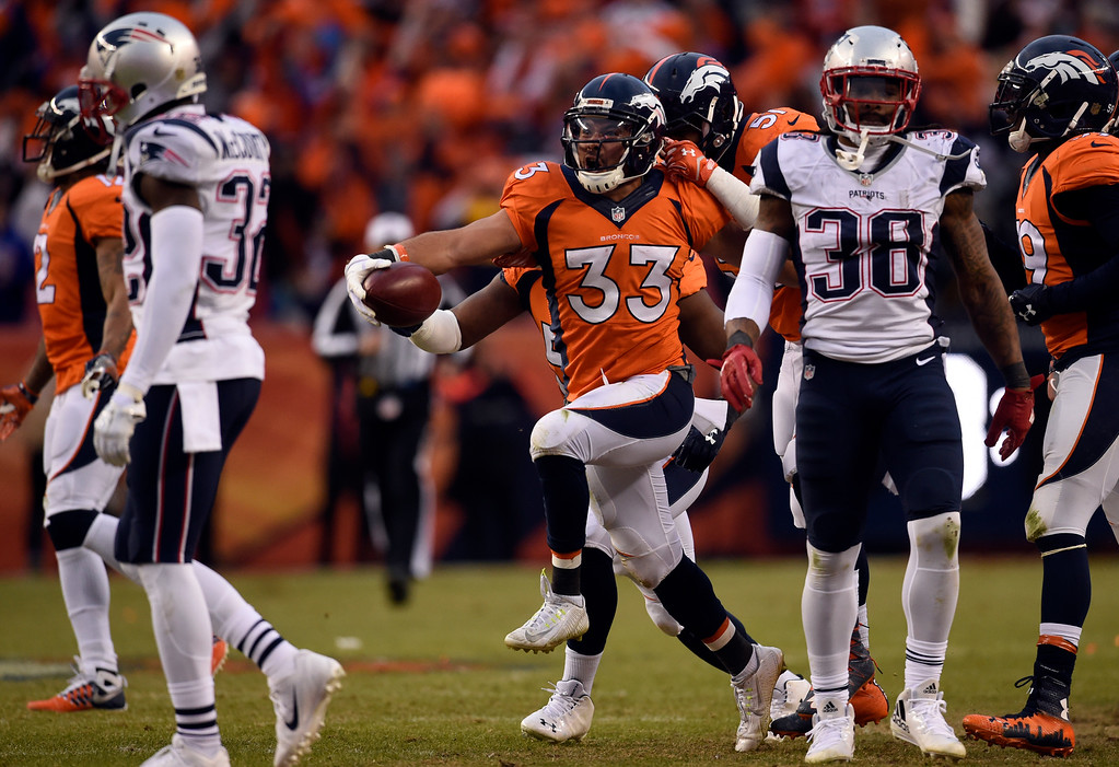 . DENVER, CO - JANUARY 24: Defensive back Shiloh Keo (33) of the Denver Broncos celebrates recovering the onside kick to end the game.  The Broncos defeated the Patriots 20 to 18.  The Denver Broncos played the New England Patriots in the AFC championship game at Sports Authority Field at Mile High in Denver, CO on January 24, 2016. (Photo by Helen H. Richardson/The Denver Post)
