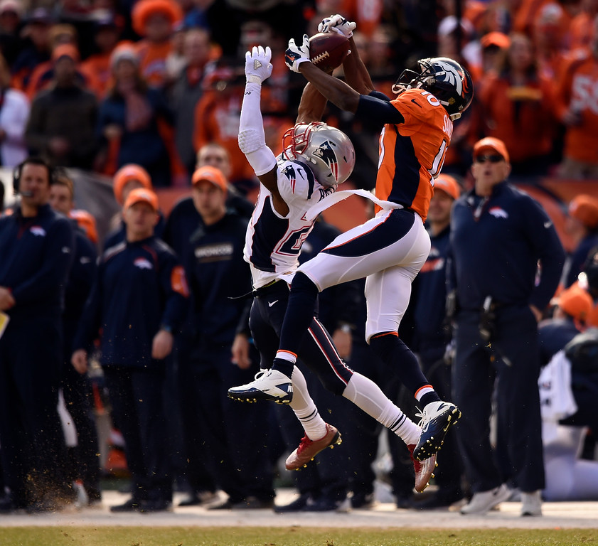 . Wide receiver Emmanuel Sanders (10) of the Denver Broncos goes up over cornerback Malcolm Butler (21) of the New England Patriots for a catch in the first quarter.  The Denver Broncos played the New England Patriots in the AFC championship game at Sports Authority Field at Mile High in Denver, CO on January 24, 2016. (Photo by John Leyba/The Denver Post)