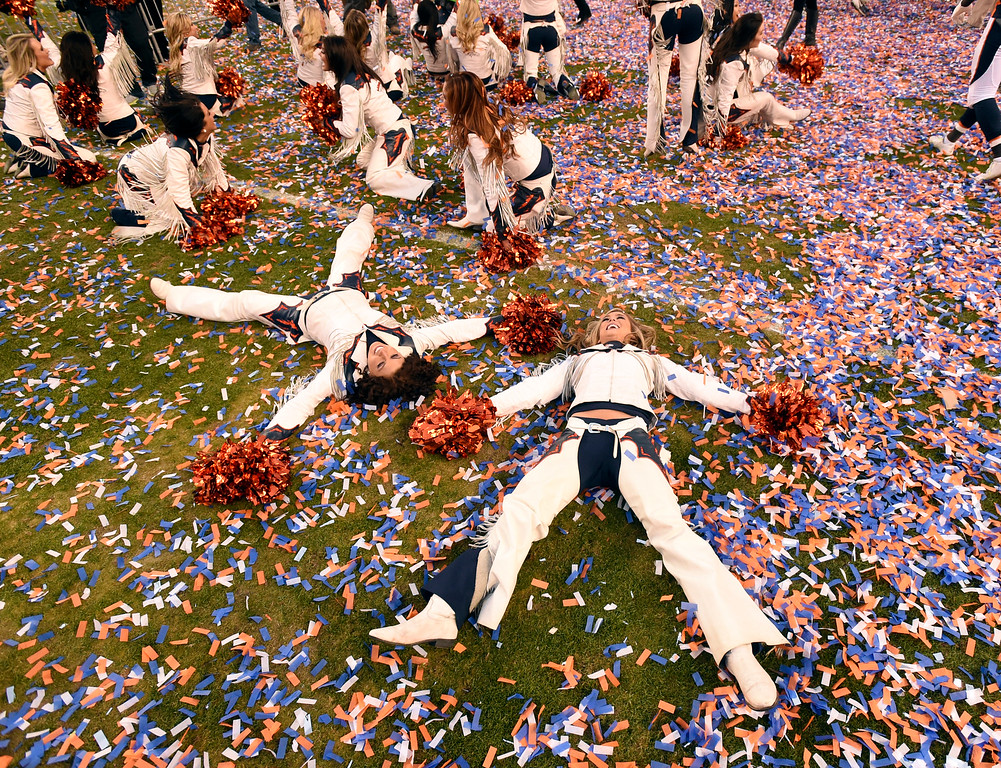 . DENVER, CO - JANUARY 24: Broncos cheerleaders make angles in the confetti after the Broncos defeated the Patriots 20 to 18 winning the AFC championship.  The Denver Broncos played the New England Patriots in the AFC championship game at Sports Authority Field at Mile High in Denver, CO on January 24, 2016. (Photo by John Leyba/The Denver Post)