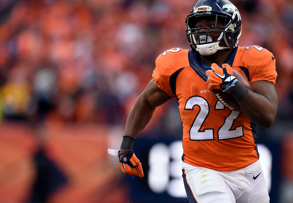 . DENVER, CO - JANUARY 24: Running back C.J. Anderson (22) of the Denver Broncos gains 30 yards in the fourth quarter.  The Denver Broncos played the New England Patriots in the AFC championship game at Sports Authority Field at Mile High in Denver, CO on January 24, 2016. (Photo by Helen H. Richardson/The Denver Post)
