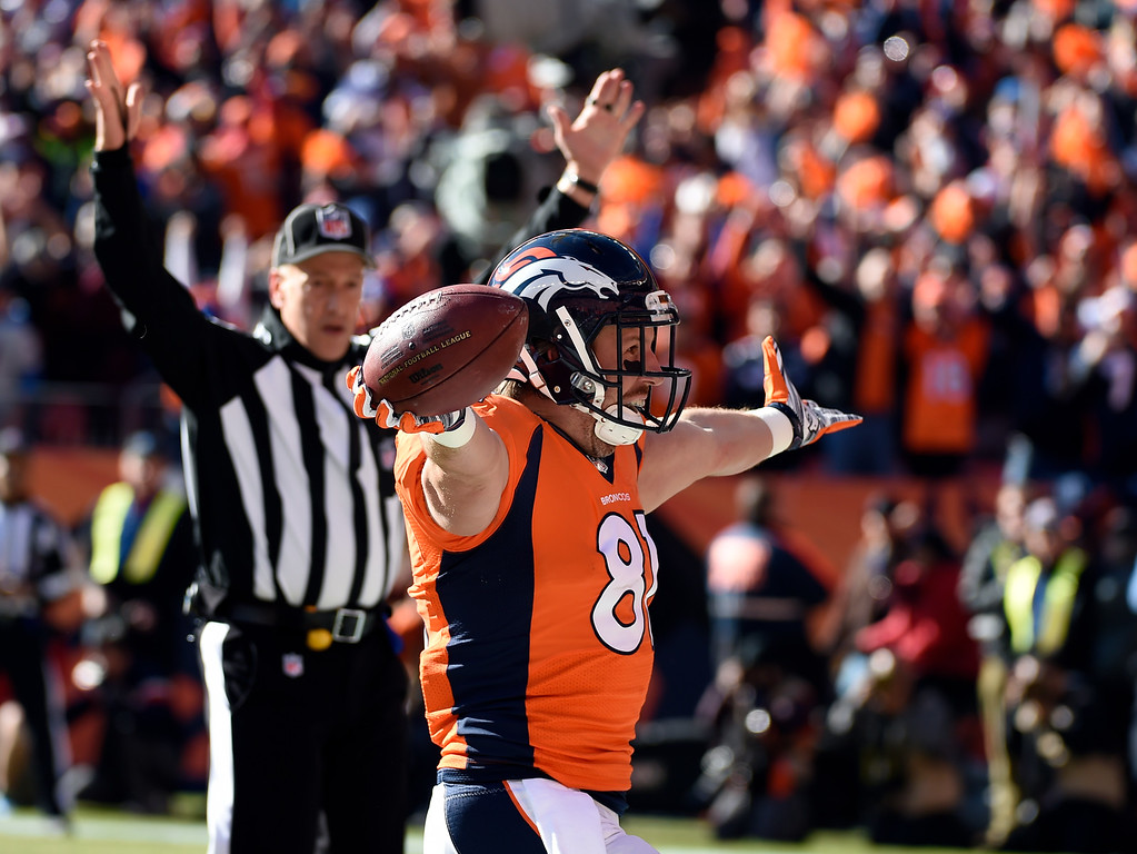 . Tight end Owen Daniels (81) of the Denver Broncos celebrates in the end zone after scoring the Broncos first touchdown of the game in the first quarter. The Denver Broncos played the New England Patriots in the AFC championship game at Sports Authority Field at Mile High in Denver, CO on January 24, 2016. (Photo by John Leyba/The Denver Post)