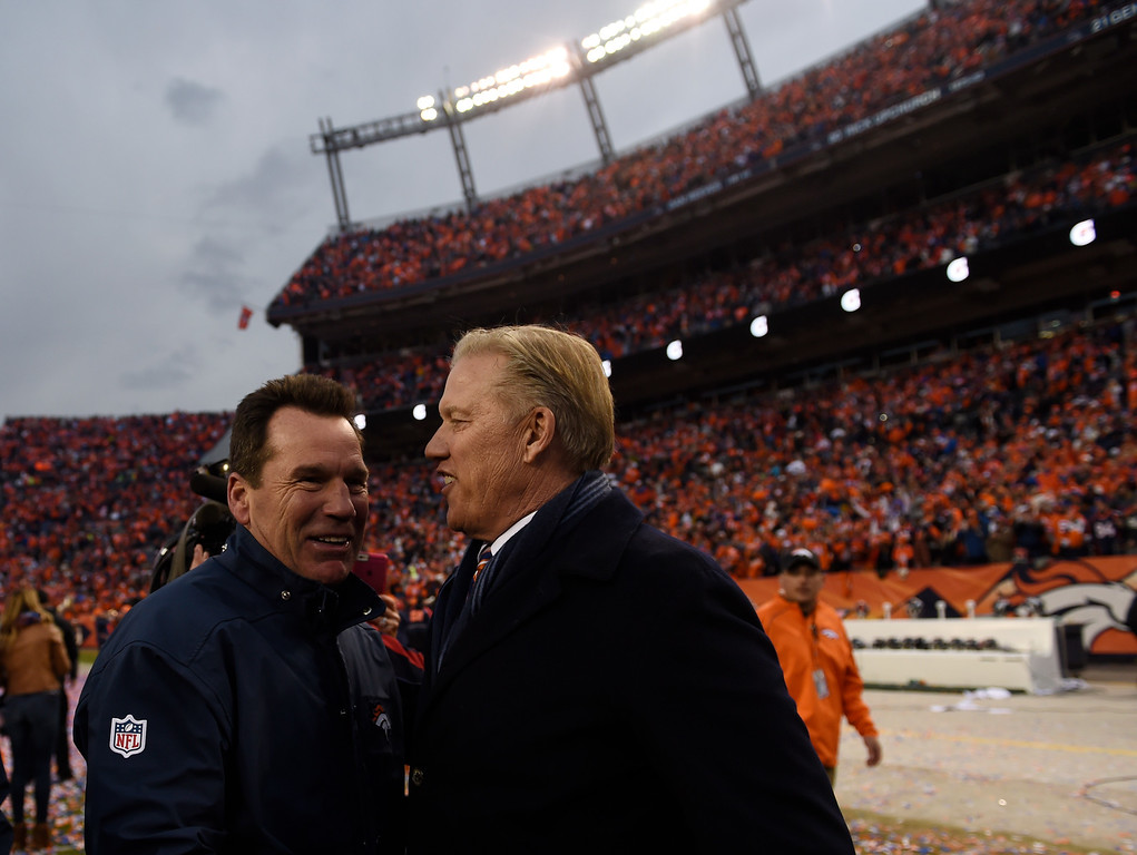 . DENVER, CO - JANUARY 24: Coach Gary Kubiak, left, and John Elway celebrate after the Denver Broncos won the AFC championship game against New England Patriots at Sports Authority Field at Mile High Stadium in Denver, January, 24, 2016. The Broncos will now go on to play in Super Bowl 50. (Photo by RJ Sangosti/The Denver Post)