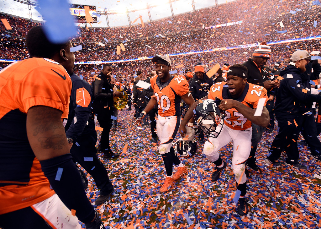 . DENVER, CO - JANUARY 24: Free safety Josh Bush (20) of the Denver Broncos and running back Ronnie Hillman (23) of the Denver Broncos dance in the confetti after the Broncos defeated the Patriots 20 to 18 winning the AFC championship.  The Denver Broncos played the New England Patriots in the AFC championship game at Sports Authority Field at Mile High in Denver, CO on January 24, 2016. (Photo by John Leyba/The Denver Post)