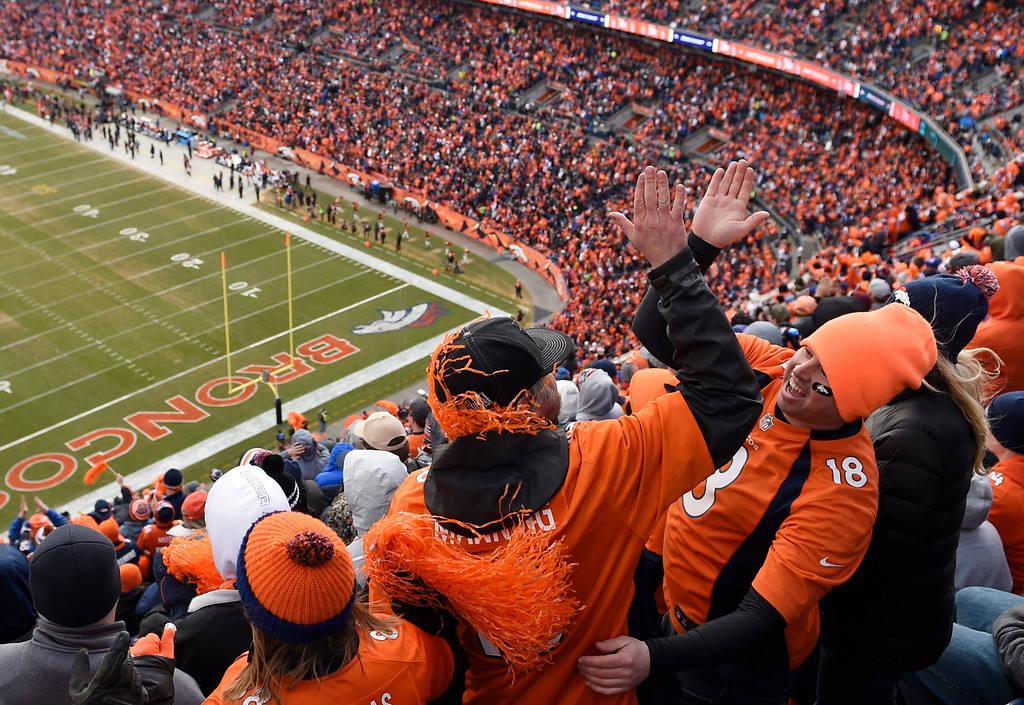 . DENVER, CO - JANUARY 24: Broncos fans cheer after Darian Stewart intercepted Tom Brady during the AFC championship game against at Sports Authority Field at Mile High Stadium in Denver, January, 24, 2016. The Denver Broncos took on New England Patriots. (Photo by RJ Sangosti/The Denver Post)