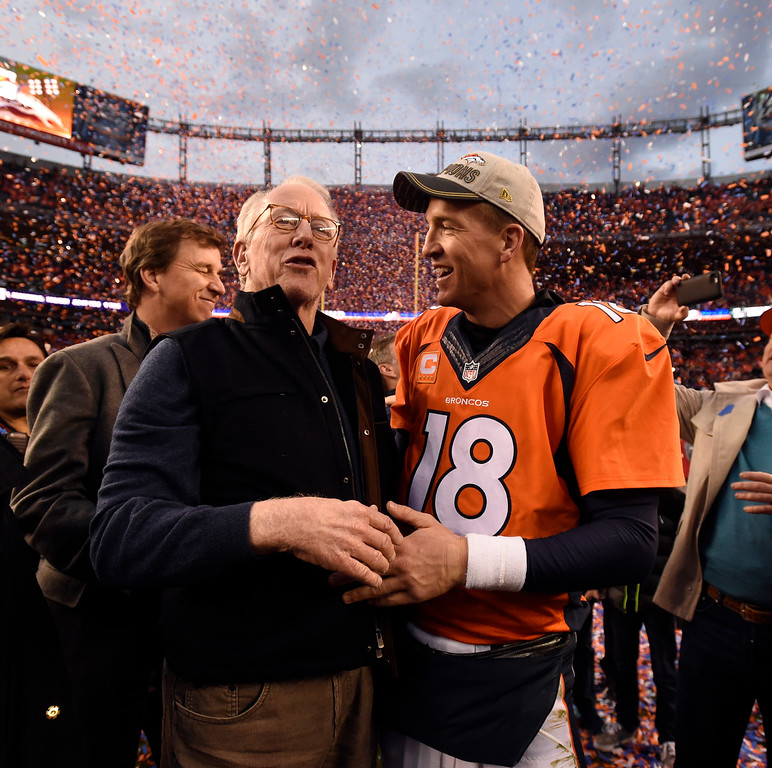 . DENVER, CO - JANUARY 24: Quarterback Peyton Manning (18) of the Denver Broncos gets a hug and is congratulated by his father Archie Manning after the Broncos defeated the Patriots 20 to 18 winning the AFC championship.  The Denver Broncos played the New England Patriots in the AFC championship game at Sports Authority Field at Mile High in Denver, CO on January 24, 2016. (Photo by John Leyba/The Denver Post)