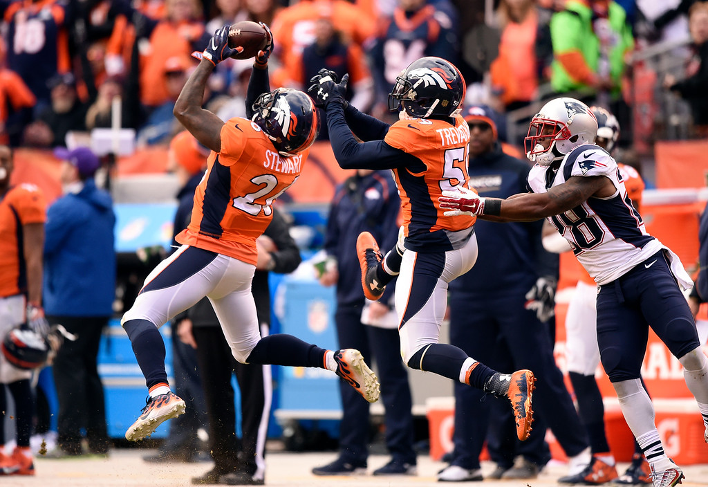 . DENVER, CO - JANUARY 24: Free safety Darian Stewart (26) of the Denver Broncos intercepts a ball thrown by quarterback Tom Brady (12) of the New England Patriots in the second quarter.  The Denver Broncos played the New England Patriots in the AFC championship game at Sports Authority Field at Mile High in Denver, CO on January 24, 2016. (Photo by John Leyba/The Denver Post)