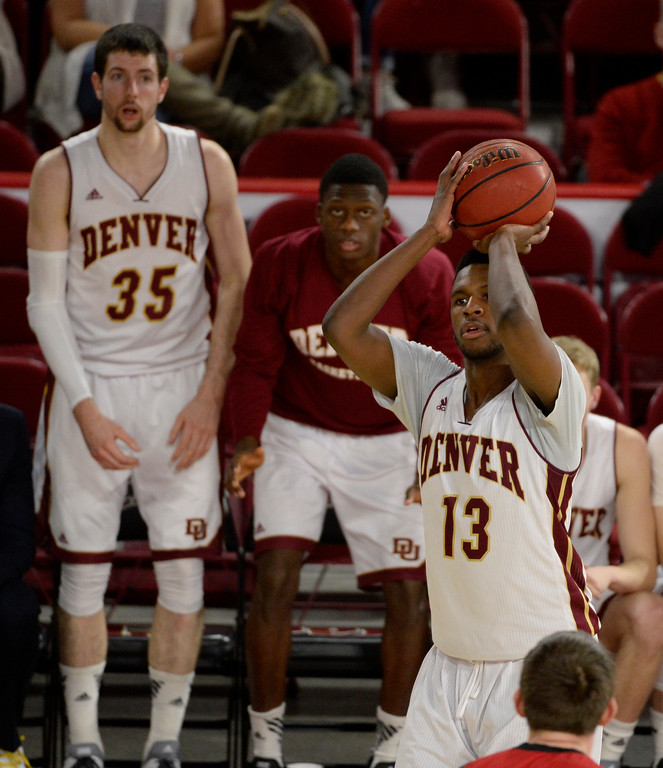 . DENVER, CO - January 28: Denver University Pioneers forward C.J. Bobbitt #13 shoots a 3-pointer against the South Dakota Coyotes in the second half at Magness Arena January 28, 2016. (Photo by Andy Cross/The Denver Post)