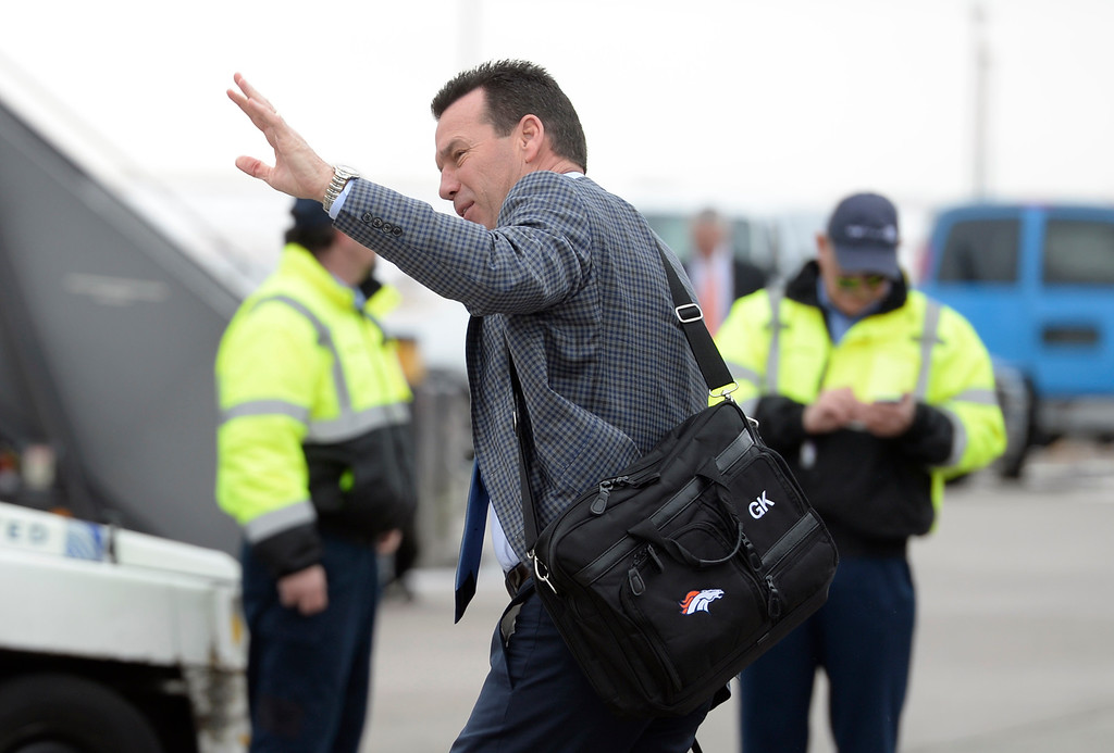 . DENVER, CO - JAN 31: Before boarding the airplane, Denver Broncos head coach Gary Kubiak pauses to wave at a small crowd of fans gathered next to the plane. The Denver Broncos depart Denver International Airport on Sunday, Jan. 31, 2016 destined for San Jose, CA. where the team will begin preparations for Super Bowl 50 on Feb. 7, 2016.(Photo by Kathryn Scott Osler/The Denver Post)