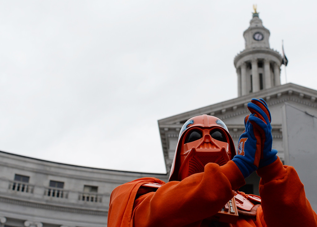 . DENVER, CO - JANUARY 31: James Chavez in an orange Darth Vader costume joins fans celebrating the Denver Broncos heading to Super Bowl 50 during a rally at Civic Center Park in Denver, January, 31, 2016. The Denver Broncos will take on Carolina Panthers at Levi\'s Stadium in Santa Clara, California. (Photo by RJ Sangosti/The Denver Post)