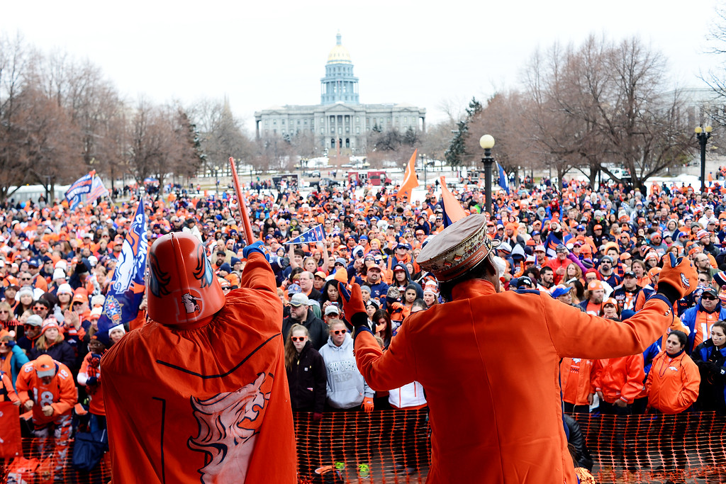 . DENVER, CO. - JANUARY 31: James Chavez aka \'Orange Vader\' (left) and Ralph Williams aka \'The Limo Driver\' hype fans from a  stage during a Denver Broncos fan rally on Sunday January 31, 2016. (Photo By AAron Ontiveroz/The Denver Post)