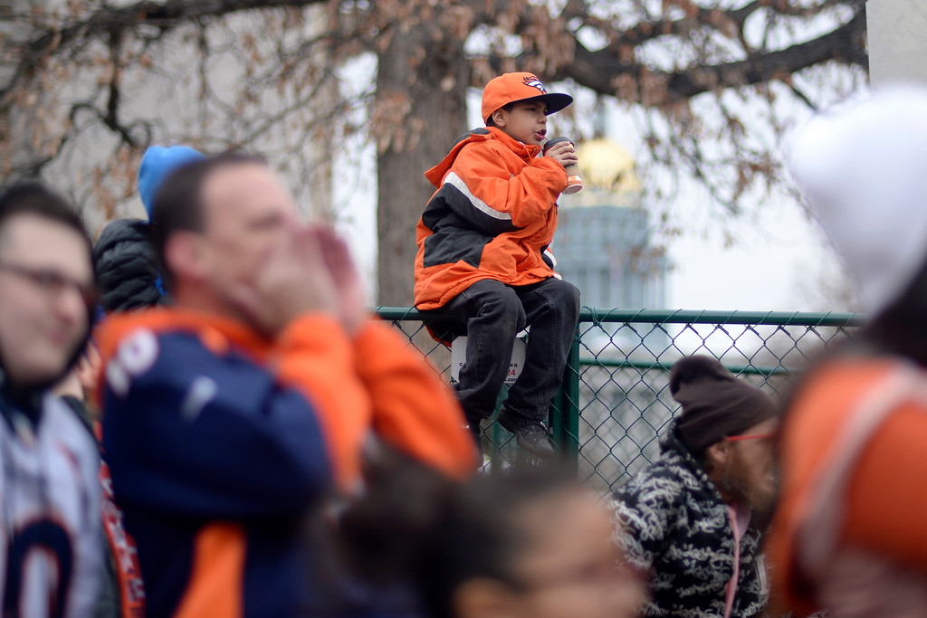 . DENVER, CO. - JANUARY 31: Raynieto Bosquez sips a drink as he gets a better vantage point on a fence  during a Denver Broncos fan rally on Sunday January 31, 2016. (Photo By AAron Ontiveroz/The Denver Post)